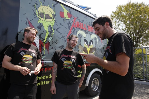 "Matt, Ryan and Jeff outside their truck, ""The Beast"""